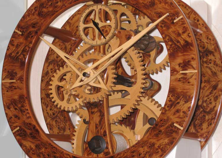 Eight day skeleton clock in burr yew